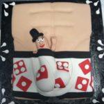 Putting-on-Ritz-New-York-top-hat-erotic-undearwear-cake